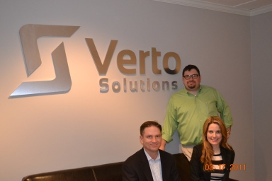 Verto Managing Directors, left to right, John H. Cox and Christie L. Harman, standing Sean V. Taylor