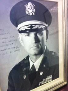 Photograph of Lt. Col. Emmett M. Cox, Jr., taken in the early 1960s, displayed in my office.